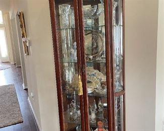. . . a beautiful curio cabinet filled with crystal treasures!