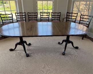 "Lot #2- $450- Dining room table-oval double pedestal, ball and claw feet. 6'-8'L (2 leaves 12"" each"" X 45""W"