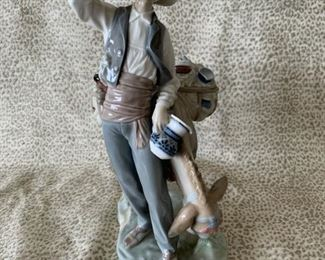 """#2 Lladro """"The Peddler"""" 4859, a peddler and his donkey, 10.5"""", retired 1985—$185"""
