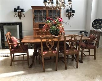 Vintage Dining Room Set:   Set of 6 Chairs with material seats and accent pillows, large dining room table with a table leaf.  Centerpiece is available.  Matching China Hutch.   Crystal is available for sale as well