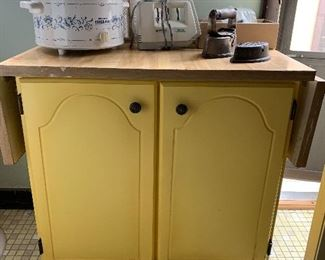 Yellow Cabinet with foldable top