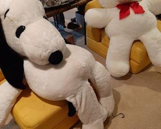 Huge Snoopy and teddy bear sitting on folding chairs that make into beds