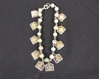 Ten Commandments charm bracelet, & Holy Family pins