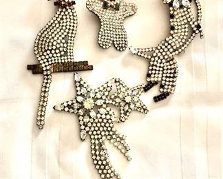 "$25 Ea - Rhinestone pins Cat on left: 4.5"" H, 2"" W."