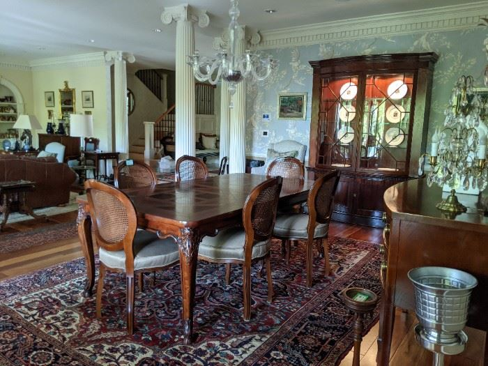 Gorgeous dining room suite, with vintage Henredon French Provincial parquet dining table, with matching chairs, Baker china cabinet, Baker Historic Charleston reproduction sideboard and fabby Persian Heriz rug.
