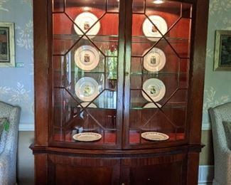 Vintage Baker lighted mahogany 2-piece china cabinet, with engineered glass shelves and bowed glass, with Vista Alegre china.