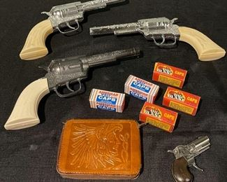 $30.00................Toy Cap Guns and Western Leather Wallet (B702)