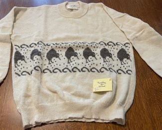 $40.00....................30% kid mohair, 60% merino lambswool Sweater made in New Zealand size Large (B756)