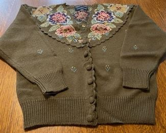 $14.00.......................Herman Geist Hand Embroidered Wool Sweater size Medium (B750)