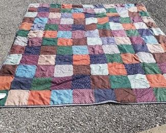 New Price $50.00  Patchwork quilt.  handmade   aprox 6'8 x 7'3 on tear on patchwork side.  some fading ,otherwise good  condition.