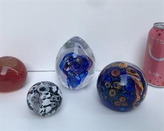 Paperweights - 2 in front are by Lindsay Art Glass