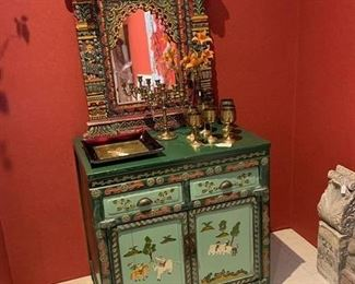 Raised carved mirror and chest