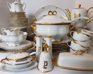 Vintage Hutschenreuther 81 pc china set in Selb pattern. Dishes are a gorgeous white with gilded gold trim. Set includes tea cups, saucers, platters, plates, soup terrain, tea pot, dessert plates, bowls, salt and pepper set, bell and sugar and creamer set. https://ctbids.com/#!/individualEstateSales/316/9887