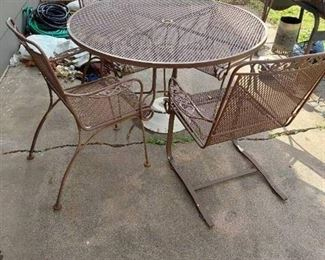 Patio Table (1 Foot is Broke) with 4 Chairs (1 Chair Rocks)