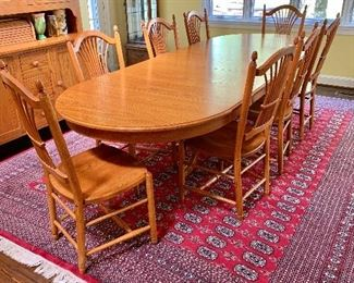 """$1395; Tom Seely signed handmade oak table and eight chairs - 29.5""""H x 112.5""""L x 41.5""""W. Chairs: 41""""H x 19.5""""W x 21""""D (seat height 18.5""""H)"""