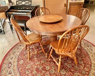 """$550 - Oak pedestal dining room table and chairs with claw feet and with removable """"Lazy Susan""""; Individual measurements 30.5""""H x 47"""" diameter. """"Lazy Susan"""" 2.5""""H x 20.5"""" diameter. Chairs 36.5""""H x 18""""W x 19""""D. Seat height 16.75""""H  Additional leaf is available"""