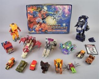 2Transformers Collector's Case and FiguresA grouping of 14 loose (not in box) Transformers toys from the late 80's to later 1990's, with a Transformers Collector's Case. Good condition, case has wear and some tears behind its vinyl cover, and figures have varying levels of wear and use.