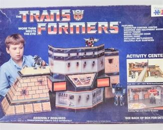 3The Transformers Activity CenterA Transformers Activity Center from the 1980's, complete with all components and original box. Good condition with significant wear to the box.