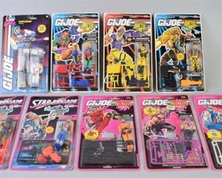 6Grouping of GI Joe Action FiguresA group of 9 carted (still in box and packaging) GI Joe action figures. Figures of interest include Outback, Dr. Mindbender, and Leatherneck. All are in very good condition with minor cosmetic wear.