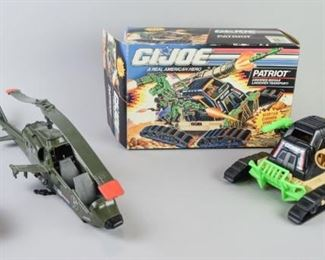 7Grouping of GI Joe VehiclesA group of GI Joe toy vehicles, including a BF-1 helicopter, a Patriot Armored Missile Transport with all parts intact and with box, and a snowmobile marked G84123-B. All in good condition.