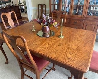 PRICE: $450                                                                                                              Dining table with 18-inch leaf, six upholstered chairs. 68 x 44 x 30.  This table has 2 drawers on each end! Matching Hutch available.