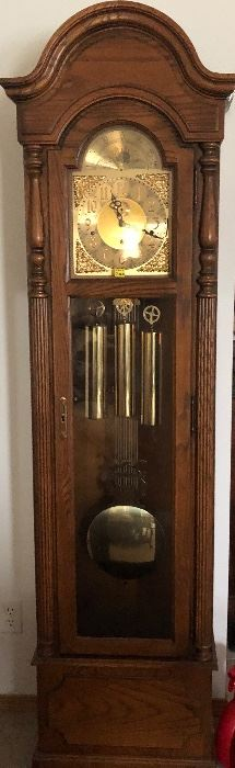 Gorgeous solid oak Howard Miller Grandfather Clock in mint condition!