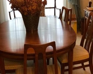 Mid century modern dining room table and 8 chairs