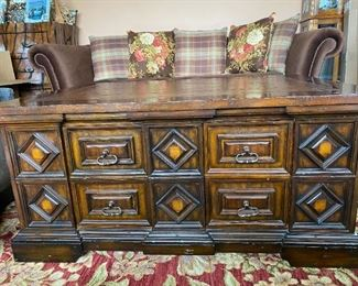 """Rustic Maitland-Smith hand carved wood and leather top coffee table.  46"""" long  35"""" wide & 21"""" high.  8 pull-out drawers with brass pulls. Few light scratches on leather top.  Excellent condition. $550.00"""