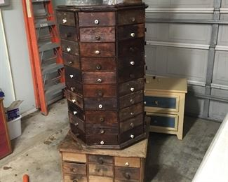 This is awesome!!! Antique spinning hardware drawer tower with all 96 drawers (and all pulls for the top!)