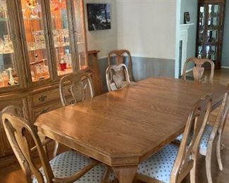 Dining room table with eight chairs and two leaves