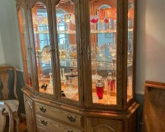 Dining room hutch loaded with cut glass and cranberry glass