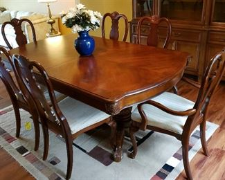 Dining table, three leaves w/skirts, four side chairs & two host's chairs.  Carving on all.