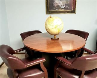 Game table, four arm chairs on rollers, globe & framed print
