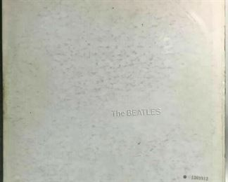 "https://www.ebay.com/itm/124680457492	BM0127B THE BEATLES ""WHITE ALBUM"" #1369912 WITH FOLD OUT POSTER	Auction"