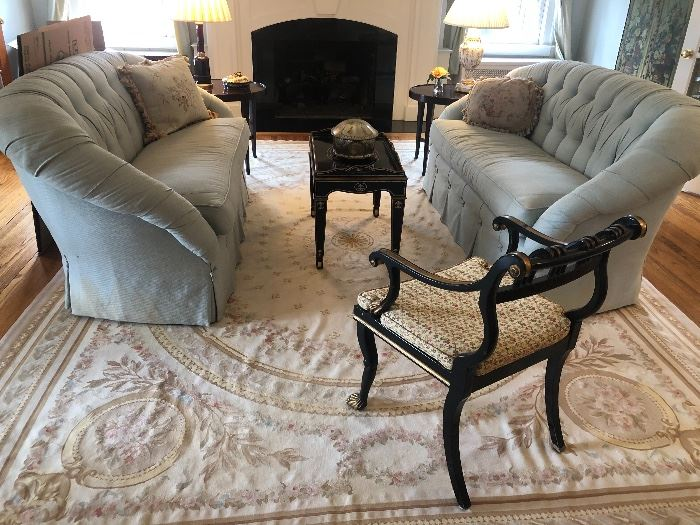 Designer single-cushion loveseats with pillows and French hand-knotted needlepoint rug