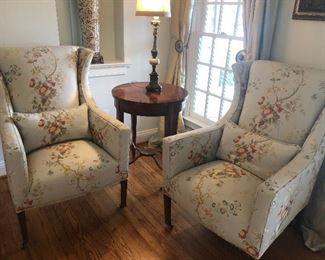 Matched set of armchairs with lumbar pillows, and tall side table and lamp