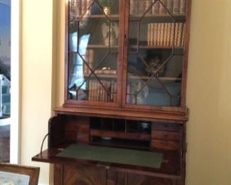 Beautiful Antique 8 drawer secretary with glass doors and locking key.  Purchased $18,000.