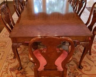 Unbelievable Baker black walnut dining table and 12 chairs measuring 12' x 4'. 3 extension leaves. Purchased chairs for $10k. Selling this rare statement dining table and chairs $40k   See pictures of overview photo