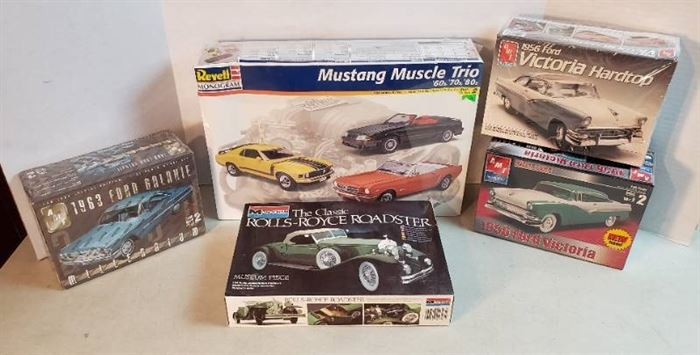Model Cars: 4 Wrapped in Plastic