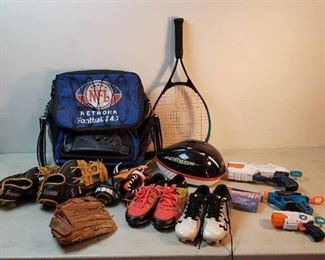 Baseball Gloves, NFL radio Bag, Tennis Racket, Cleats (size 2), Bicycle Helmet and Netflix Guns w/pkg. of Darts