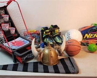 Mini Basketball Challenge Game, Schwinn Youth Roller Skates, Soccer Ball, Mini Nike Basketball, Netflix Backboard w/ball, Lunch Pail, and 2 Dress up Hats