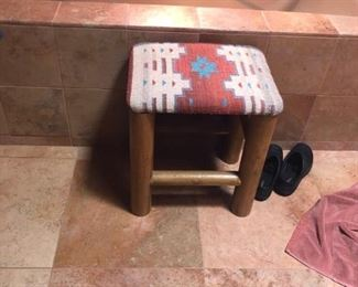 One of two footstools with Navajo upholstery.