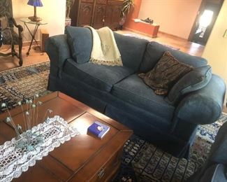 One of two comfy blue velveteen loveseats.