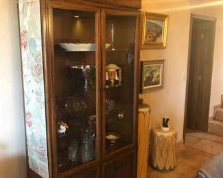 Mid-century modern walnut china cabinet framed by an eight foot vintage silk obi.