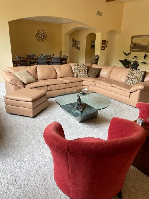 Custom made leather sofa console with matching ottoman.