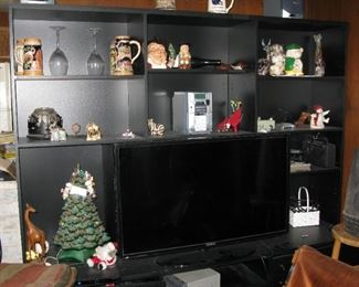 large black wall unit. steins, glassware, pottery