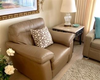 """This sale offers 2 """"like new""""  Natuzzi Editions Chairs — one is an electric recliner and one is not. Both are great looking, and SO comfortable."""