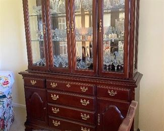 Gorgeous cherry china cabinet, lighted with beveled glass.