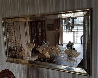 Vintage beveled mirror with osprey