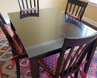 Black Dining Room Table and Four Black Chairs